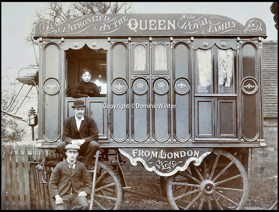 BNPS.co.uk (01202 558833)Pic: DominicWinter/BNPS<br /> <br /> 'Patronized by the Queen and the Royal family' - Circus performers pose for photograph infront of plush cart. <br /> <br /> These remarkable photos capture life in a 19th century touring circus which twice performed for the Queen.<br /> <br /> The collection of over 150 images tells the story of the circus of 'Lord' George Sanger who performed for Queen Victoria at Sandringham in 1885 and at Balmoral Castle in 1898. <br /> <br /> One remarkable photo shows the whole troupe of 30 performers in front of the circus ring with the acrobats forming a three people high human pyramid in the background.<br /> <br /> Tragically, in 1911 Sanger was murdered with a hatchet at his home at Park Farm, Finchley, by employee Herbert Charles Cooper, who then committed suicide.