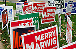 Campaign signs blanket the lawn out front of a voting facility ahead of an election, Wdnesday, Nov. 2, 2016. (DePaul University/Jeff Carrion)