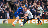 Eden Hazard of Chelsea holds off Harry Kane of Spurs during the Premier League match between Chelsea and Tottenham Hotspur at Stamford Bridge, London, England on 1 April 2018. Photo by Andy Rowland.