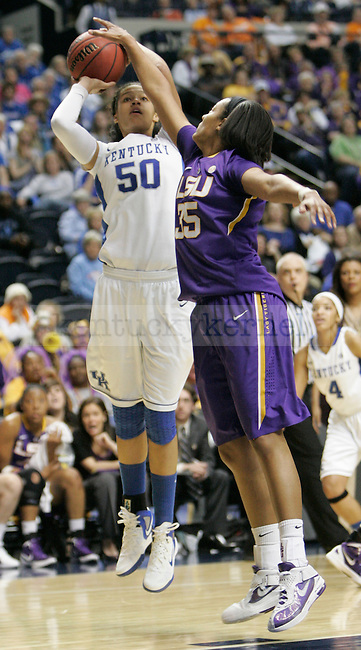 Freshman forward Azia Bishop is blocked by LSU senior forward Taylor Turnbow during the SEC Women's Basketball Tournament game UK Hoops vs. LSU at Bridgestone Arena in Nashville, Tenn., on Saturday, Mar. 3, 2012. Photo by Tessa Lighty | Staff