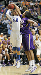 Freshman forward Azia Bishop is blocked by LSU senior forward Taylor Turnbow during the SEC Women's Basketball Tournament game UK Hoops vs. LSU at Bridgestone Arena in Nashville, Tenn., on Saturday, Mar. 3, 2012. Photo by Tessa Lighty | Staff