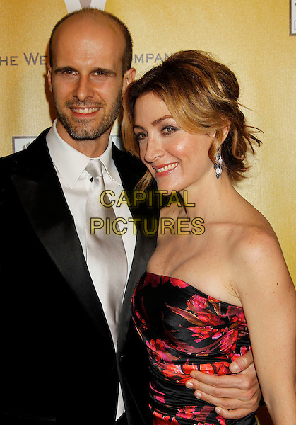 EDOARDO PONTI & SASHA ALEXANDER.Weinstein Company Post Golden Globe Party held at Bar210 & Plush Ultra Lounge at the Beverly Hilton Hotel, Beverly Hills, California, USA..January 17th, 2009.globes half length black white suit pink orange floral print strapless silk satin dress couple stubble facial hair.CAP/ADM/MJ.©Michael Jade/Admedia/Capital Pictures