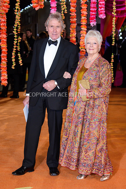 WWW.ACEPIXS.COM<br /> <br /> February 17 2015, London<br /> <br /> Dame Judi Dench (R) and David Mills attending The Royal Film Performance and World Premiere of 'The Second Best Exotic Marigold Hotel' at Odeon Leicester Square on February 17, 2015 in London<br /> <br /> By Line: Famous/ACE Pictures<br /> <br /> <br /> ACE Pictures, Inc.<br /> tel: 646 769 0430<br /> Email: info@acepixs.com<br /> www.acepixs.com