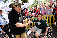 Musician Ted Nugent, left, speaks with a fan during a public appearance, Wednesday, April 15, 2009, at the Alamo in San Antonio. (Darren Abate/pressphotointl.com)