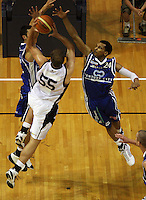 Saints forward Arthur Trousdell and guard Mike Efevberha try to block Chris Reay during the NBL Round 2 basketball match between the Wellington Saints and Nelson Giants at TSB Bank Arena, Wellington, New Zealand on Thursday 19 March 2009. Photo: Dave Lintott / lintottphoto.co.nz