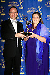 """BEVERLY HILLS - JUN 22: Guillermo Arduino, Magdalena Cabral with the award for 'Clix"""" for the Outstanding Entertainment Program in Spanish at The 41st Annual Daytime Emmy Awards Press Room at The Beverly Hilton Hotel on June 22, 2014 in Beverly Hills, California"""