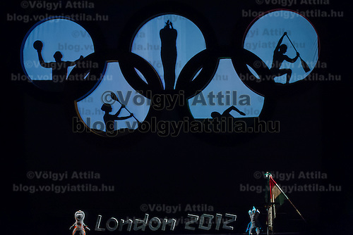 Members of the Attraction Blacklight Theatre perform a shadow play during the swearing in ceremony of the Hungarian Olympic Team that will travel to London in Budapest, Hungary on June 22, 2012. ATTILA VOLGYI