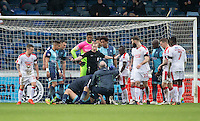 Referee Gavin Ward calls for calm as Luke O'Nien of Wycombe Wanderers receives treatment during the Sky Bet League 2 match between Wycombe Wanderers and Crawley Town at Adams Park, High Wycombe, England on 25 February 2017. Photo by Andy Rowland / PRiME Media Images.