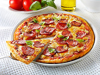 Pizza topped with pepperoni & cheese  with a slice out photo.Funky Stock pizzas photos
