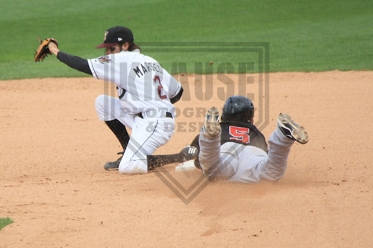 APPLETON - JULY 2010: Rafael Ynoa (5) of the Great Lakes Loons, Class-A affiliate of the Los Angeles Dodgers, slides in to second base during a game on July 19, 2010 at Fox Cities Stadium in Appleton, Wisconsin. (Photo by Brad Krause)