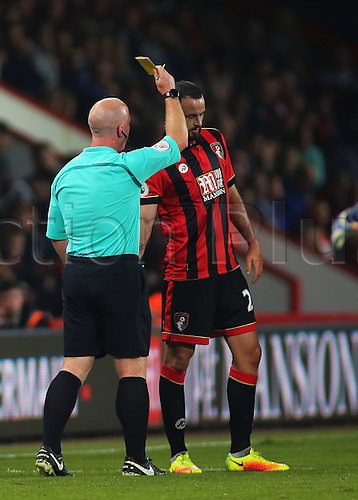 20.09.2016. Vitality Stadium, Bournemouth, England. Football League Cup Football. Bournemouth versus Preston. Bournemouth Defender Marc Wilson receives a yellow card off Referee Simon Hooper for rough challenge on Preston Midfielder Daniel Johnson