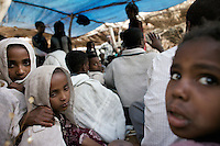 Etinesh, 11 years old, on left and Torokan, 8 years old, center, sit in the bridal tent while celebrations for their marriages take place in a village in Northern Amhara region on February 14, 2009 in Ethiopia..While in decline, early child marriage is still widely spread in rural areas of Ethiopia where families sell their daughters into marriage at ages as young as 5 years old...Names of subjects have been fictionalized and specific locations have been omitted to protect the identities of the children portrayed in the story.