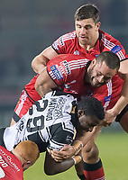 Picture by Allan McKenzie/SWpix.com - 16/03/2018 - Rugby League - Betfred Super League - Salford Red Devils v Hull FC - AJ Bell Stadium, Salford, England - Hull FC's Masimbaashe Matongo is tackled by Salford's Josh Wood, Weller Hauraki & Tyrone McCarthy.