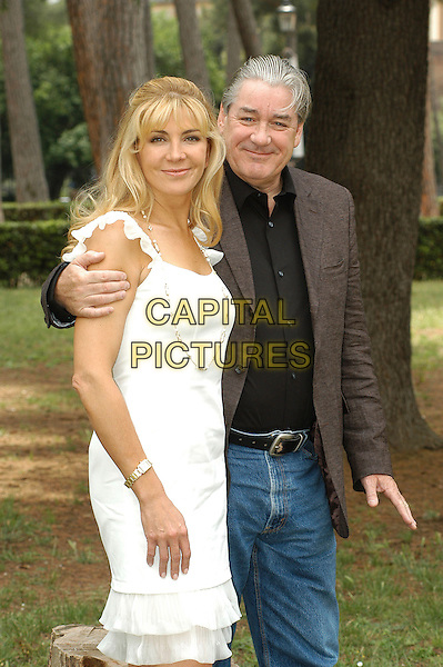"NATASHA RICHARDSON & PATRICK McGRATH.Photocall for ""Asylum"", Rome, Italy..June 6th, 2007.half length white dress brown suit jacket arm over shoulder .CAP/CAV.©Luca Cavallari/Capital Pictures"