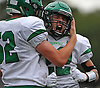 Rich Hickis #22 of Farmingdale, right, gets congratulated by Luke Woodland #52 after making a catch on fourth down for his second touchdown reception of the day in a Nassau County Conference I varsity football game against host Massapequa High School on Saturday, Sept. 22, 2018. Farmingdale won by a score of 41-27.
