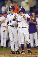 LSU Tigers shortstop Alex Bregman #30 and outfielder Mark Laird #9 wait for teammate Raph Rhymes to come home after his first inning home run against the Auburn Tigers in the NCAA baseball game on March 22nd, 2013 at Alex Box Stadium in Baton Rouge, Louisiana. LSU defeated Auburn 9-4. (Andrew Woolley/Four Seam Images).