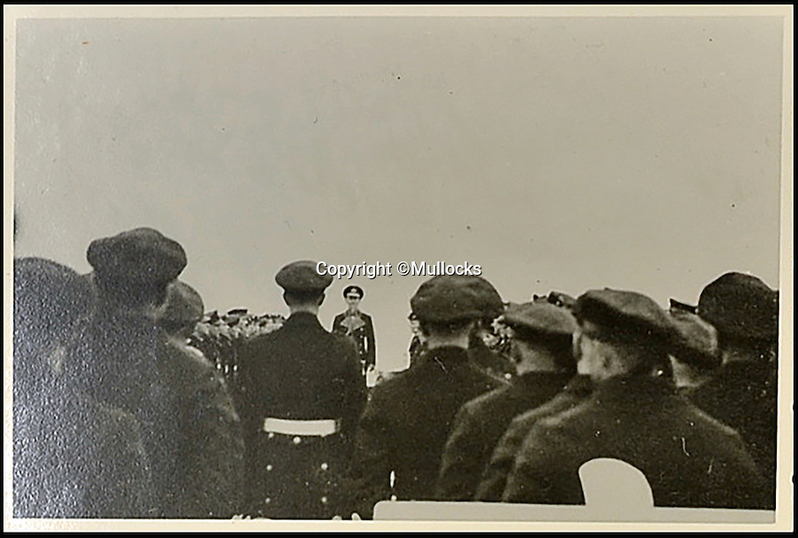 BNPS.co.uk (01202 558833)<br /> Pic: Mullocks/BNPS<br /> <br /> Sailors are issued with their final orders before the Fuhrer comes onboard.<br /> <br /> A German sailor's personal photo album capturing Hitler's visit to his doomed ship on which almost 2,000 men later perished has emerged for the first time. <br /> <br /> Showing the Fuhrer inspecting the ill-fated crew and greeting senior personnel, the 81 images were taken on board the infamous Nazi battleship Scharnhorst between 1939 and 1940. <br /> <br /> The 771ft vessel was sunk during the Battle of the North Cape in 1943 by HMS Duke of York with only 36 of a crew of 1,968 surviving. <br /> <br /> And this album, compiled by an unidentified German sailor, shows what life was like on Scharnhorst before that day. It will be sold by Mullocks Auctions in Shropshire on October 18 with a £650 estimate.