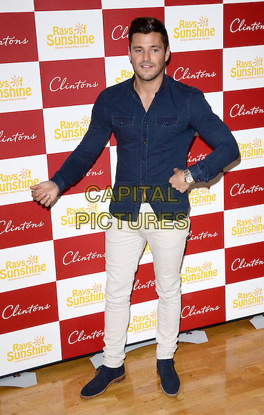 GREENHITHE, ENGLAND - OCTOBER 26:  Mark Wright signs copies of his official 2014 calendar at Clintons at Bluewater Shopping Centre with a percentage of proceeds from sales going to Rays of Sunshine, a charity that grants wishes for seriously and terminally ill children across the UK aged 3-18 on October 26, 2013 in Greenhithe, Kent, England.  <br /> CAP/PP/MB<br /> &copy;Michael Ball/PP/Capital Pictures