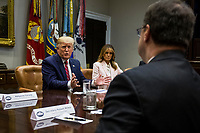 U.S. President Donald Trump speaks during an opioid round table at the White House in Washington, DC, USA, 12 June 2019. At left is U.S. First Lady Melania Trump.<br /> Credit: Zach Gibson / Pool via CNP/AdMedia