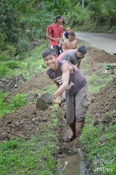 Jaime Papiyona digs a ditch for a water pipe as part of a cash for work program in the village of Cambayan in the Philippines province of Samar. The region was hit hard by Typhoon Haiyan in November 2013. Known locally as Yolanda, the storm left much of the community's infrastructure a shambles. Norwegian Church Aid, a member of the ACT Alliance, is helping the community rehabilitate its potable water system as well as build new toilets.