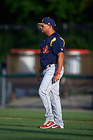 State College Spikes pitching coach Darwin Marrero (39) walks to the mound during a game against the Auburn Doubledays on July 6, 2015 at Falcon Park in Auburn, New York.  State College defeated Auburn 9-7.  (Mike Janes/Four Seam Images)