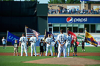 West Michigan Whitecaps pitcher Jeff Ferrell #17, third baseman Jason King, shortstop, Brandon Loy, second baseman Colin Kaline, first baseman Aaron Westlake during the national anthem before a game against the Bowling Green Hot Rods at Fifth Third Ballpark on June 26, 2012 in Comstock Park, Michigan.  West Michigan defeated Bowling Green 13-11.  (Mike Janes/Four Seam Images)