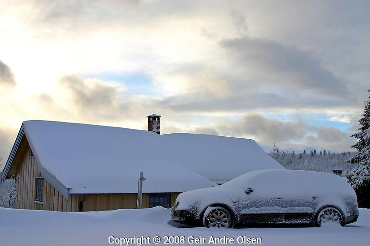 Frozen car, winter in the Norwegian mountains near Ringebu