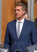 United States Senator Jeff Flake (Republican of Arizona) stands and listens to the opening statements as the US Senate Committee on the Judiciary meets to vote on the nomination of Judge Brett Kavanaugh to be Associate Justice of the US Supreme Court to replace the retiring Justice Anthony Kennedy on Capitol Hill in Washington, DC on Friday, September 28, 2018.  If the committee votes in favor of Judge Kavanaugh then it goes to the full US Senate for a final vote.<br /> Credit: Ron Sachs / CNP<br /> (RESTRICTION: NO New York or New Jersey Newspapers or newspapers within a 75 mile radius of New York City)