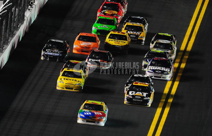 Feb 12, 2011; Daytona Beach, FL, USA; NASCAR Sprint Cup Series driver Kyle Busch leads the field during the Bud Shootout at Daytona International Speedway. Mandatory Credit: Mark J. Rebilas-