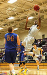 SIOUX FALLS, SD - NOVEMBER 24: Kebu Johnson #4 from the University of Sioux Falls takes the ball to the basket past Taylor Zirbel #34 from Dakota State University in the first half of their game Monday night at the Stewart Center.  (Photo by Dave Eggen/Inertia)