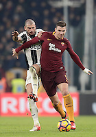 Calcio, Serie A: Juventus vs Roma. Torino, Juventus Stadium,17 dicembre 2016. <br /> Roma's Edin Dzeko, right, is challenged by Juventus' Stefano Sturaro during the Italian Serie A football match between Juventus and Roma at Turin's Juventus Stadium, 17 December 2016.<br /> UPDATE IMAGES PRESS/Isabella Bonotto