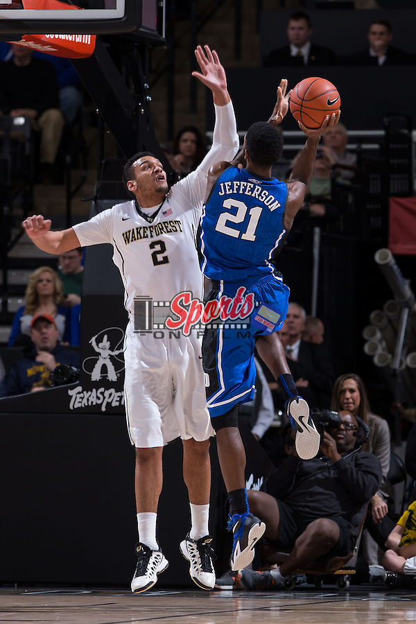 Amile Jefferson (21) of the Duke Blue Devils attempts to shoot over Devin Thomas (2) of the Wake Forest Demon Deacons during first half action at the LJVM Coliseum on January 7, 2015 in Winston-Salem, North Carolina.  The Blue Devils defeated the Demon Deacons 73-65.  (Brian Westerholt/Sports On Film)