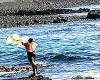 A local fisherman throws his net near the shore, Big Island; throw net fishing (or 'upena kiloi) is still popular in Hawai'i and utilizes both ancient and modern methods of fishing.