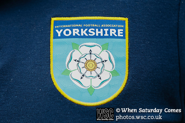 The YIFA logo on a polo shirt. Yorkshire v Parishes of Jersey, CONIFA Heritage Cup, Ingfield Stadium, Ossett. Yorkshire's first competitive game. The Yorkshire International Football Association was formed in 2017 and accepted by CONIFA in 2018. Their first competative fixture saw them host Parishes of Jersey in the Heritage Cup at Ingfield stadium in Ossett. Yorkshire won 1-0 with a 93 minute goal in front of 521 people. Photo by Paul Thompson