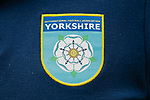 The YIFA logo on a polo shirt. Yorkshire v Parishes of Jersey, CONIFA Heritage Cup, Ingfield Stadium, Ossett. Yorkshire's first competitive game. The Yorkshire International Football Association was formed in 2017 and accepted by CONIFA in 2018. Their first competative fixture saw them host Parishes of Jersey in the Heritage Cup at Ingfield stadium in Ossett. Yorkshire won 1-0 with a 93 minute goal in front of 521 people.