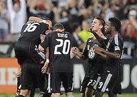 D.C. United forward Dwayne De Rosario (7) celebrates with teammate Josh Wolff (16), Stephen King (20) Perry Kitchen (23) and Clyde Simms (19) his first goal in the 22th minute of the game.  D.C. United defeated Real Salt Lake 4-0 at RFK Stadium, Saturday September 24 , 2011.