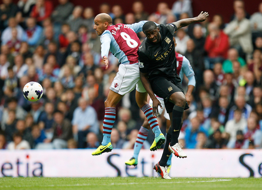 Aston Villa's Karim El Ahmadi (L) and Manchester City's Yaya Toure in action during todays match  <br /> <br /> Photo by Jack Phillips/CameraSport<br /> <br /> Football - Barclays Premiership - Aston Villa v Manchester City - Saturday 28th September 2013 - Villa Park - Birmingham<br /> <br /> &copy; CameraSport - 43 Linden Ave. Countesthorpe. Leicester. England. LE8 5PG - Tel: +44 (0) 116 277 4147 - admin@camerasport.com - www.camerasport.com