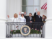 Mrs. Brigitte Macron(L), U.S. first lady Melania Trump(2nd L), French President Emmanuel Macron(2nd R) and United States President Donald J. Trump(R)appear on the Truman Balcony during a state visit to The White House in Washington, DC, April 24, 2018. Credit: Chris Kleponis / Pool via CNP