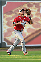 Great Lakes Loons outfielder Alex Santana (21) catches a fly ball during a game against the West Michigan Whitecaps on June 4, 2014 at Fifth Third Ballpark in Comstock Park, Michigan.  West Michigan defeated Great Lakes 4-1.  (Mike Janes/Four Seam Images)