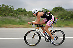 OCEANSIDE, CA- APRIL 2:  Heather Wuertell of Canada rides her bike through Camp Pendleton during Rohto Ironman 70.3 California in Oceanside, California on April 2, 2011. (Photo by Donald Miralle for LAVA Magazine) *** Local Caption ***
