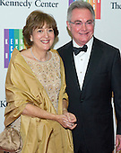 Cappy R. McGarr and his wife, Janie, arrive for the formal Artist's Dinner honoring the recipients of the 2013 Kennedy Center Honors hosted by United States Secretary of State John F. Kerry at the U.S. Department of State in Washington, D.C. on Saturday, December 7, 2013. The 2013 honorees are: opera singer Martina Arroyo; pianist,  keyboardist, bandleader and composer Herbie Hancock; pianist, singer and songwriter Billy Joel; actress Shirley MacLaine; and musician and songwriter Carlos Santana.<br /> Credit: Ron Sachs / CNP