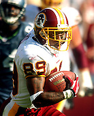 Landover, MD - October 2, 2005 -- Washington Redskins wide receiver Santana Moss (89) makes extra yards after catching a Mark Brunell pass in overtime against the Seattle Seahawks at FedEx Field in Landover, MD on October 2, 2005.  The Redskins won the game in overtime 20 - 17..Credit: Ron Sachs / CNP