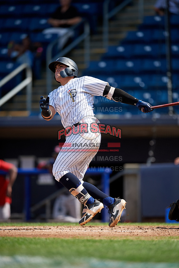 Staten Island Yankees third baseman Andres Chaparro (26) hits a home run during a game against the Lowell Spinners on August 22, 2018 at Richmond County Bank Ballpark in Staten Island, New York.  Staten Island defeated Lowell 10-4.  (Mike Janes/Four Seam Images)