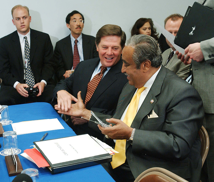 5/22/03.TAX CUT CONFERENCE--House Majority Leader Tom DeLay, R-Texas, and House Ways and Means ranking Democrat Charles B. Rangel, D-N.Y., greet each other before the conference..CONGRESSIONAL QUARTERLY PHOTO BY SCOTT J. FERRELL
