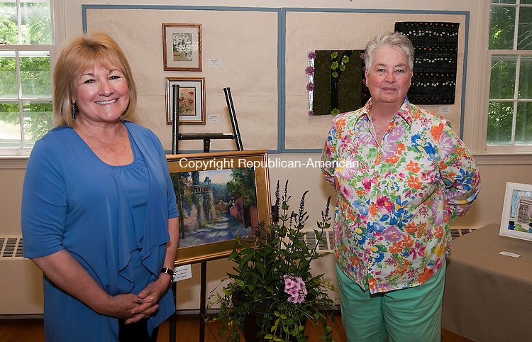HARWINTON, CT-062114JS28--Linda Colasurdo of Torrington, left, and Marlyn (CQ) Rout of Harwinton at the second annual Harwinton Congregational Church's Art in Bloom garden tour and art show in Harwinton. <br /> Jim Shannon Republican-American