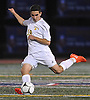 Alessandro Sambone #19 of Massapequa makes a free kick from midfield during the Nassau County Class AA varsity boys soccer semifinals against Syosset at Cold Spring Harbor High School on Monday, Oct. 31, 2016. He scored the game-winning goal on a penalty kick in the third minute of overtime to lift the Chiefs to a 2-1 win.