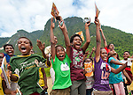 School kids get amped up a a RARE Pride rally in Lobo Village, Triton Bay, Papua.