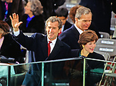 Businessman George W. Bush waves from the podium prior to his Dad, United States President-elect George H.W. Bush being sworn-in as 41st President of the United States at the US Capitol on January 20, 1989.  At right is his wife, Laura Bush.<br /> Credit: Arnie Sachs / CNP