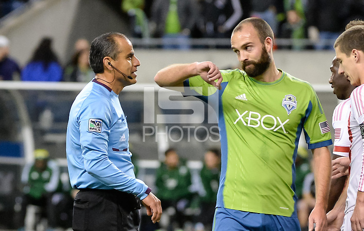 November, 2013: CenturyLink Field, Seattle, Washington:  Seattle Sounders FC midfielder Adam Moffat (26) complains to referee Baldomero Toledo about being elbowed as the Portland Timbers take on the Seattle Sounders FC in the Major League Soccer Playoffs semifinals Round. Portland won the first match 2-1.