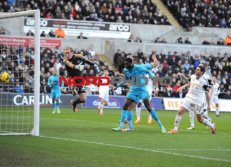 Tottenham Hotspur's Emmanuel Adebayor heads past Swansea City's Gerhard Tremmel to open the scoring -   19/01/2014 - SPORT - FOOTBALL - Liberty Stadium - Swansea - Swansea City v Tottenham Hotspur - Barclays Premier League<br /> Foto nph / Meredith<br /> <br /> ***** OUT OF UK *****